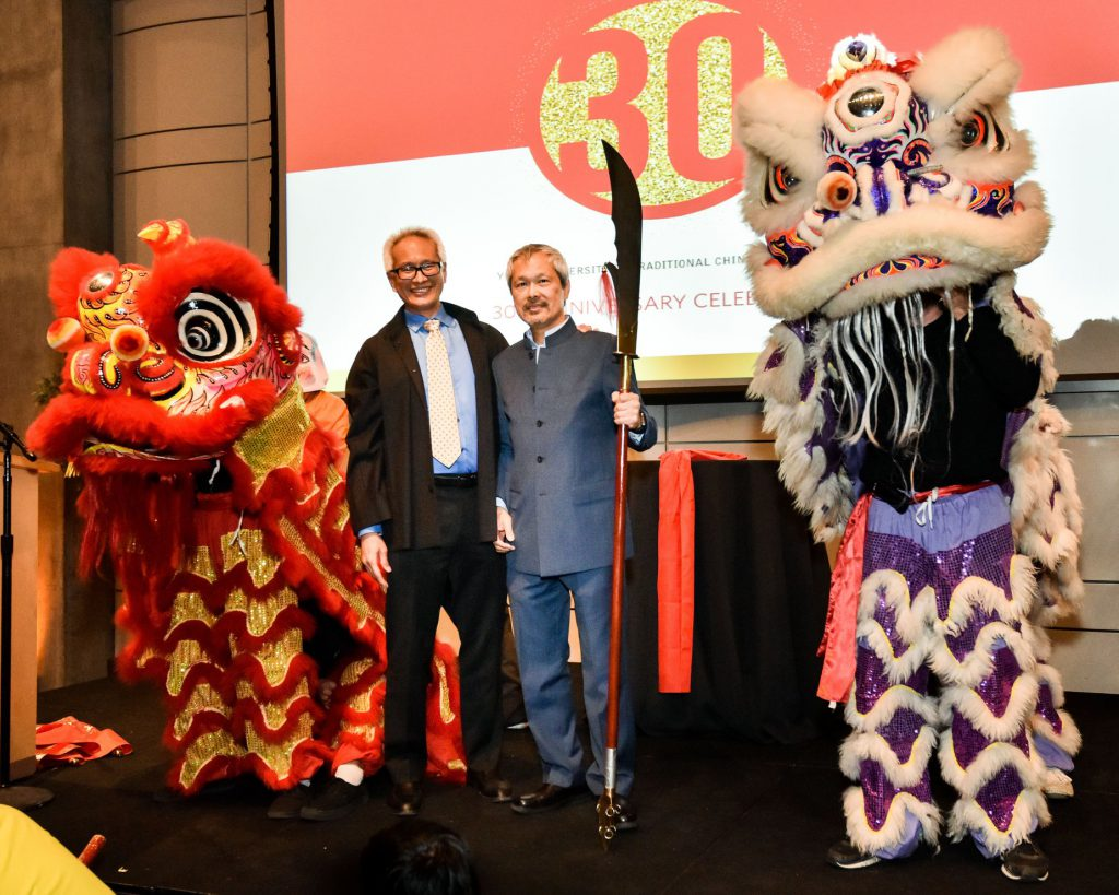 Yo San University 30th Anniversary Gala, Founders Dao and Mao stand with Lion Dancers